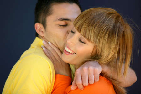 Young couple kissing Stock Photo - 11842661