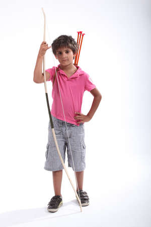 Little boy with bow and arrow photo