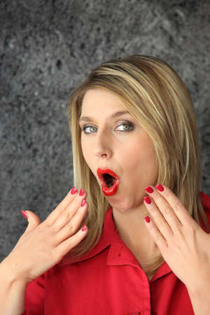 Woman blowing her nails photo