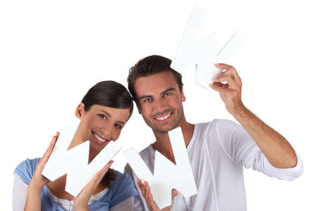web presence internet presence: Couple holding the letters WWW Stock Photo