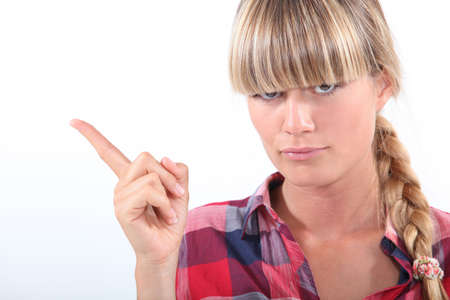 dissuade: Woman pointing her finger Stock Photo