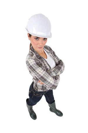 high angle shot of brunet standing apprentice cross-armed Stock Photo - 11842920