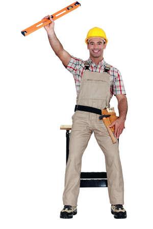 Carpenter celebrating with a spirit level Stock Photo - 11842898