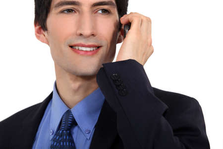 office use: Young businessman using mobile telephone