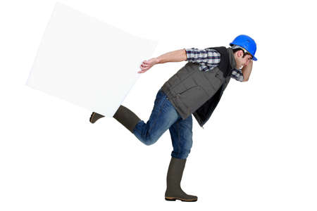 Builder running with blank poster photo