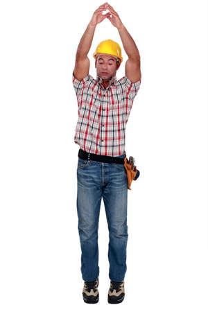 tradesperson: Tradesman raising his arms over his head