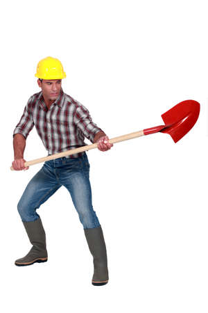 craftsman holding a shovel photo