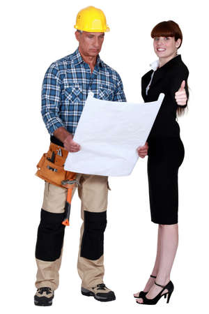 Architect and builder with plans photo