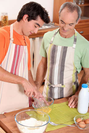 father and son cooking photo
