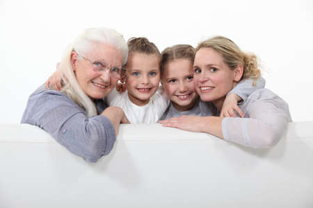 75 80: Family portrait of three generations Stock Photo