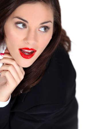 Woman wearing bright red lipstick photo