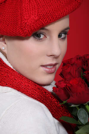 Woman in a red beret with red roses photo