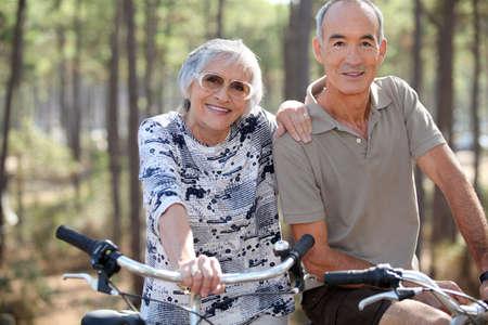 Elderly couple on bike ride photo