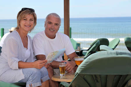 Couple having a drink on holiday Stock Photo - 11842727
