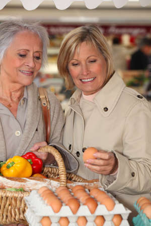 50 55 years: Mother and daughter shopping at the market together Stock Photo