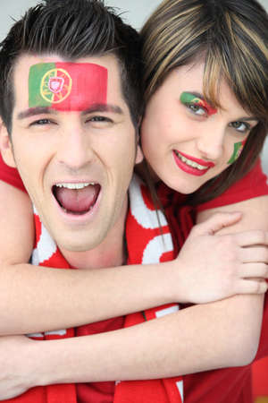 Couple of Portuguese football supporters photo