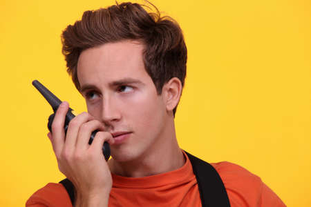 crucial: male worker using a talkie walkie Stock Photo