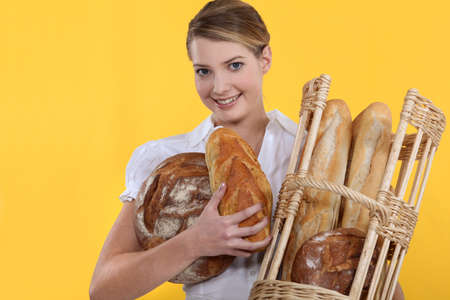 french bakery: Bakery worker holding basket