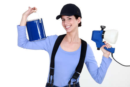 Woman holding paint sprayer Stock Photo - 11842470