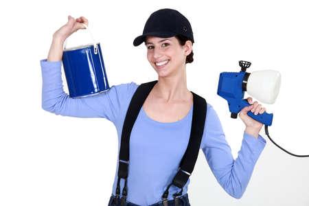 Woman holding paint sprayer Stock Photo - 11842470