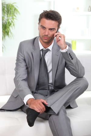 Pensive businessman relaxing photo
