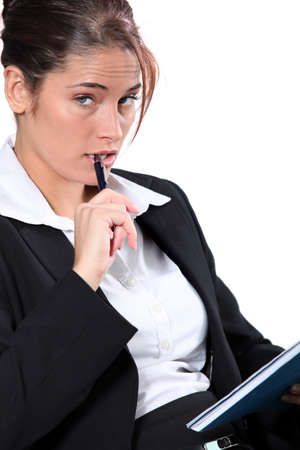 30 34 years: Portrait of woman in a suit with pen and notepad Stock Photo