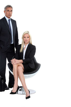 collaborators: Sharp suited business duo Stock Photo