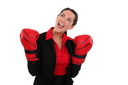 Smiling businesswoman wearing boxing gloves Stock Photo - 11842490