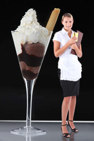 fair haired: pretty blonde waitress standing on table near giant ice cream