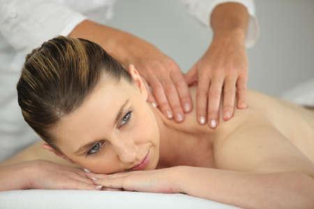 Woman having a back massage photo