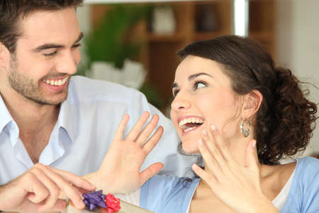gift giving: Surprising his girlfriend with gift Stock Photo