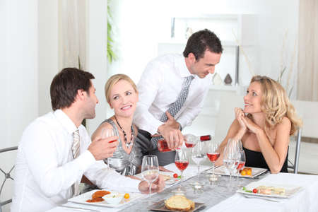 lifestyle dining: Friends having a dinner party Stock Photo