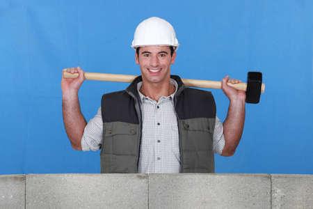 sledgehammer: Builder with a sledgehammer Stock Photo
