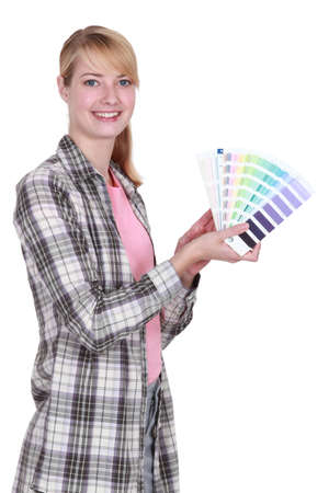 female painter holding color charts photo