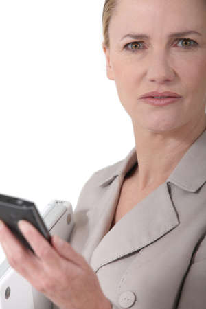 Female executive with cellphone Stock Photo - 11843796