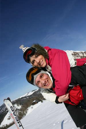 Young couple skiing photo