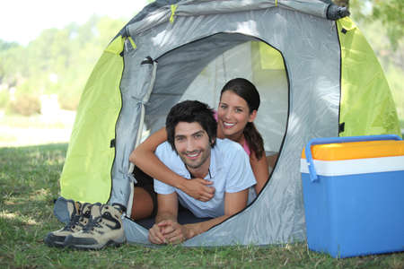 portrait of a couple in a tent photo