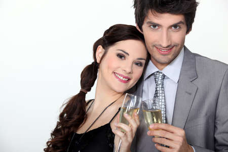 a couple toasting sparkling wine glasses photo