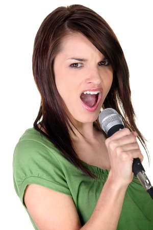 Brunette woman singing photo