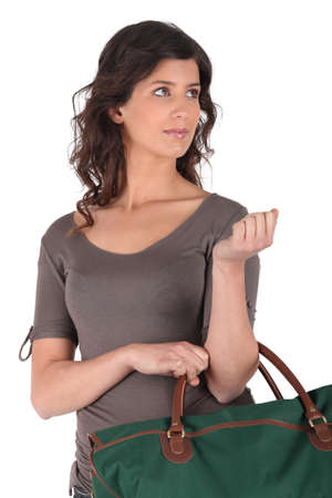 Brunette holding luggage photo