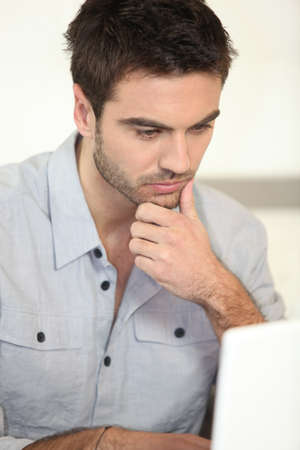 evaluating: Man working from home Stock Photo