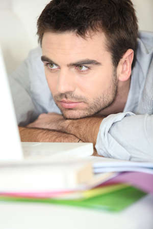 Man sick of studying photo