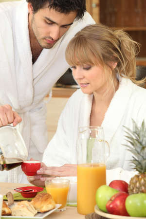 young couple having breakfast together photo