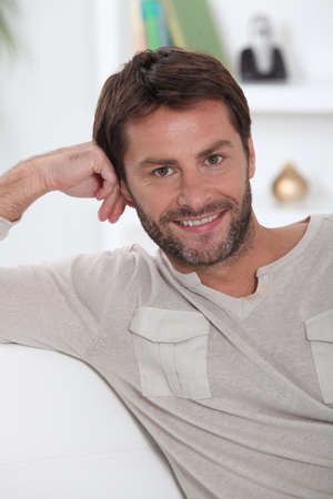 Man relaxing in his front room Stock Photo - 11843383