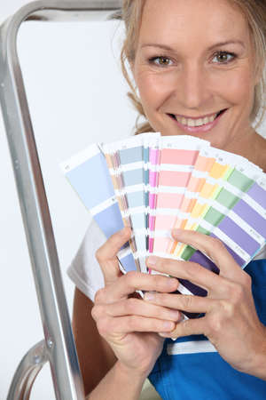 Female decorator with a selection of color swatches photo
