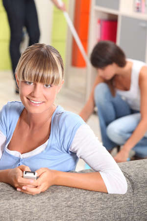 undergrad: Young women doing the chores Stock Photo