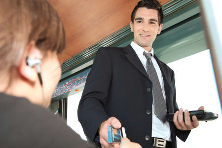 man in suite: Tram conductor checking ticket