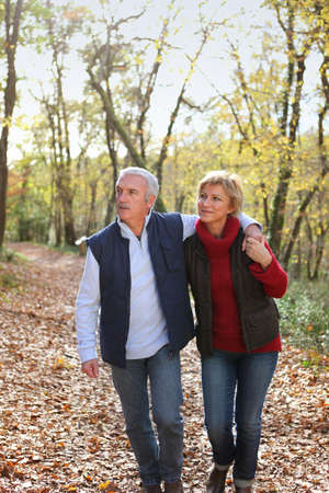 Couple taking romantic stroll in the park photo