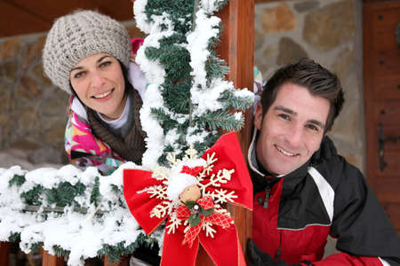 Couple staying in a Christmas chalet photo