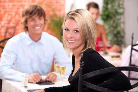 out of date: happy couple at restaurant